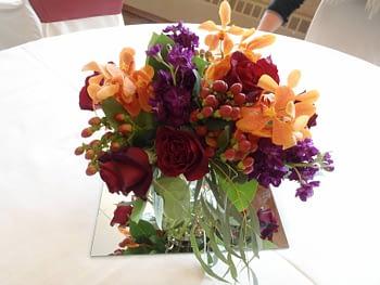 st paul minneapolis wedding flowers centerpiece red orange purple