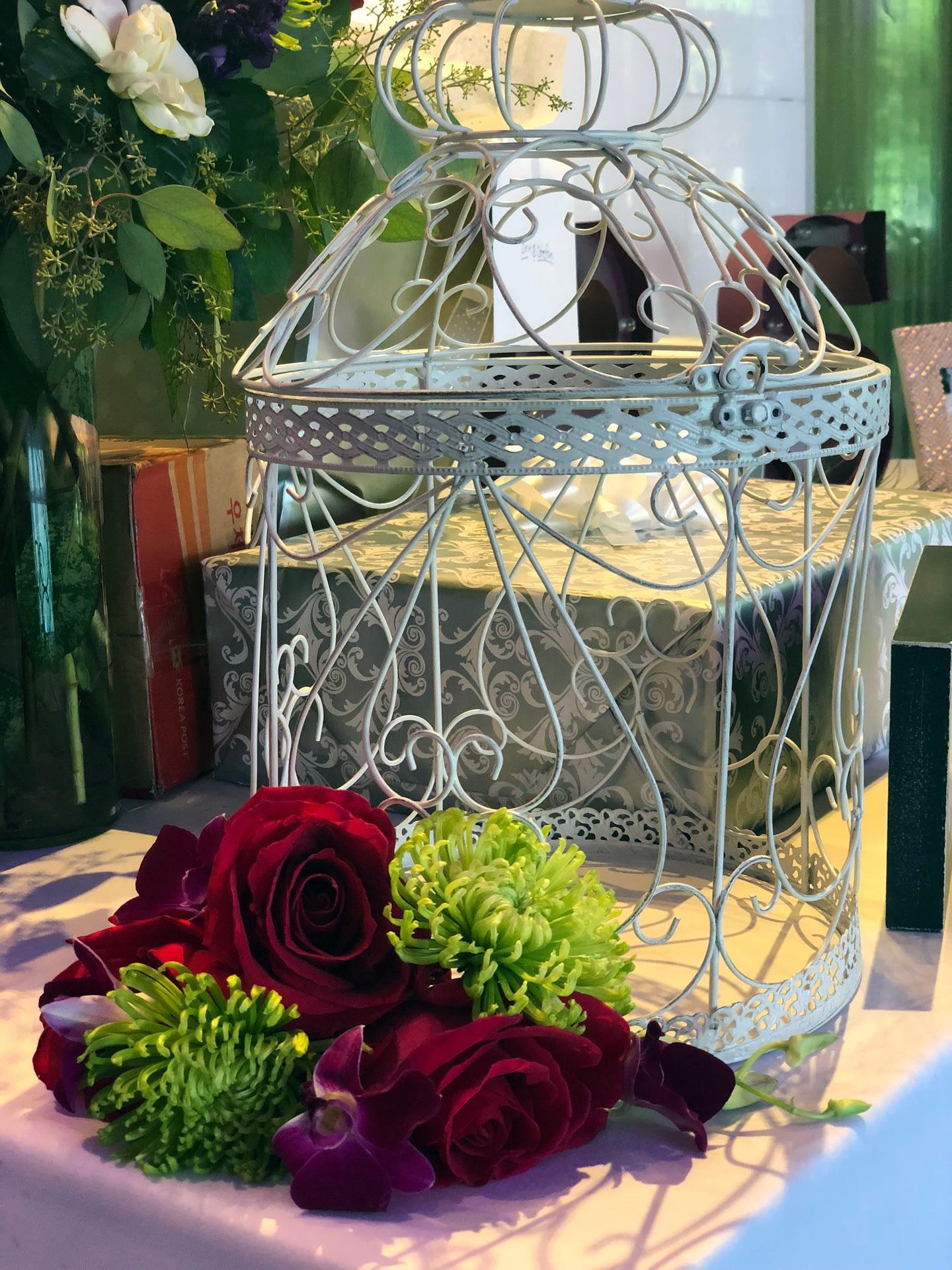 bright flowers with birdcage minneapolis wedding